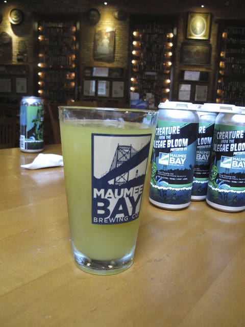 "A glass of ""Alegae Bloom"" beer at Maumee Bay Brewing Co. in Toledo, Ohio, on Wednesday, Sept. 12, 2018. The brewery is making the green, murky beer to draw attention to the algae blooms that taint Lake Erie's water. (AP Photo/John Seewer)"