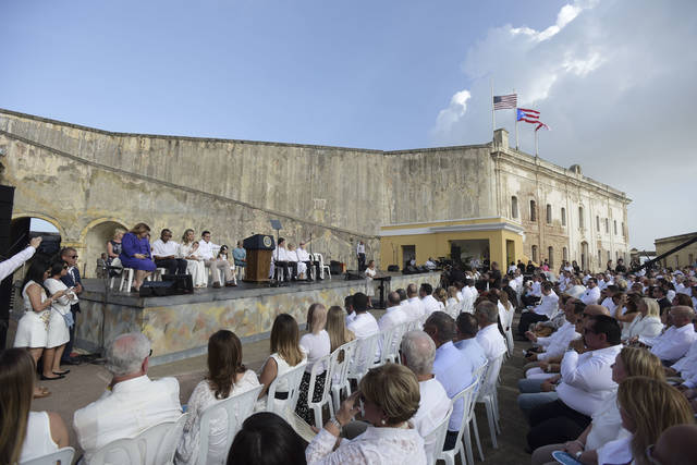 Dignitaries and guests attend a remembrance ceremony convened by the Governor of Puerto Rico Ricardo Rossello at the San Cristobal Castle, on the anniversary of Hurricane Maria, in San Juan, Puerto Rico, Thursday, September 20, 2018. Hurricane Maria left almost three thousand dead, caused economic losses amounting hundreds of millions of dollars and left a path of destruction and damaged infrastructure through the island. (AP Photo Carlos Giusti)