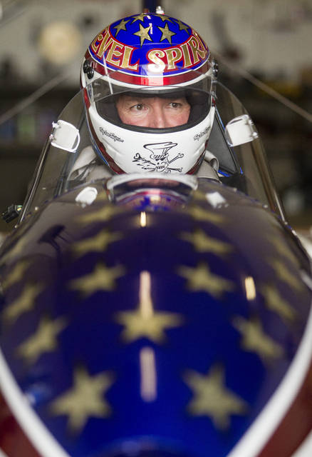 "FILE - In this Sept. 1, 2016, file photo, stuntman Eddie Braun sits in the cockpit of the ""Evel Spirit"", a steam-powered rocket, at the team's shop in Twin Falls, Idaho. The new documentary titled ""Stuntman"", backed by the production company of action star Dwayne Johnson, is a nearly 90-minute film about Braun's career as a stuntman and his successful jump over the Snake River Canyon in a steam-powered rocket cycle on Sept. 16, 2016. (Drew Nash/The Times-News via AP, File)"