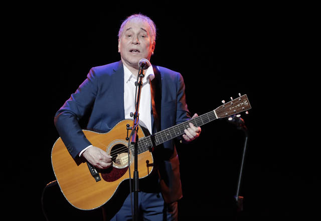 FILE - In a Sept. 22, 2016 file photo, musician Paul Simon performs during the Global Citizen Festival, in New York.  Simon wraps up his farewell concert tour Saturday, Sept. 22, 2018 at a park in Queens, a bicycle ride across the borough from where he grew up. The 76-year-old singer picked Flushing Meadows Corona Park to say goodbye, an outdoor show on the first night of autumn.   (AP Photo/Julie Jacobson, File)