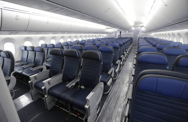 FILE - In this Jan. 26, 2016, file photo, economy class seating is shown on a new United Airlines Boeing 787-9 undergoing final configuration and maintenance work at Seattle-Tacoma International Airport in Seattle. The Federal Aviation Administration would be required to set new minimum requirements for seats on airplanes under legislation to be considered in the House this week. The regulation of seat width and legroom is part of a five-year extension of federal aviation programs agreed to early Saturday, Sept. 22, 2018, by Republican and Democratic leaders of the House and Senate committees that oversee the nation's air travel. (AP Photo/Ted S. Warren, File)