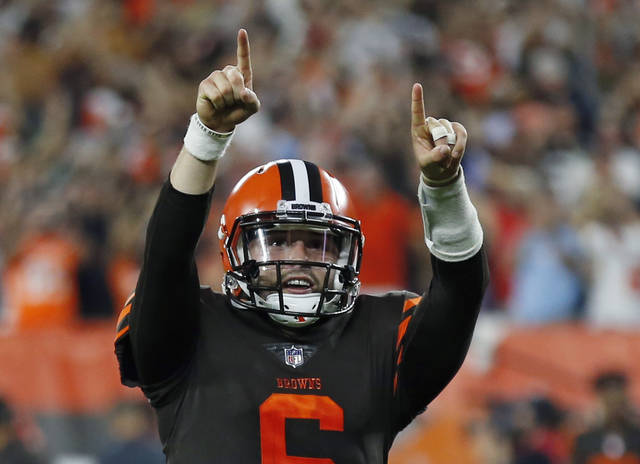 FILE - In this Thursday, Sept. 20, 2018, file photo, Cleveland Browns quarterback Baker Mayfield celebrates a 1-yard touchdown by running back Carlos Hyde during the second half of an NFL football game against the New York Jets, in Cleveland. Rookie Baker Mayfield has a new gig _ starting quarterback. Browns coach Hue Jackson made the switch to Mayfield official on Monday, Sept. 24, 2018, and the No. 1 pick will make his first start Sunday at Oakland. Jackson decided to make the move after Mayfield replaced an injured Tyrod Taylor on Thursday night and led the Browns to a 21-17 come-from-behind win over the New York Jets _ Cleveland's first since 2016. (AP Photo/Ron Schwane, File)
