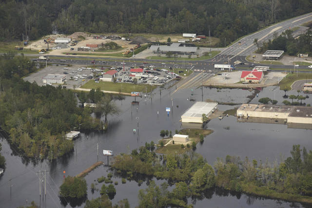 In this Monday, Sept. 24, 2018 photo, flood waters from the Neuse River cover the area a week after Hurricane Florence in Kinston, N.C. Monday Sept. 24, 2018.  (Ken Blevins/The Star-News via AP)