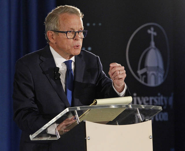 FILE - In this Sept. 19, 2018, file photo, gubernatorial candidate, Republican Mike DeWine, speaks during a debate with his opponent Democrat Richard Cordray at the University of Dayton in Dayton, Ohio. Letters from the physicians of DeWine and Democrat Richard Cordray were produced at the request of The Associated Press. The two are in a close, expensive race this fall to replace Republican Gov. John Kasich, who's term-limited. (Ty Greenless/Dayton Daily News via AP, File)