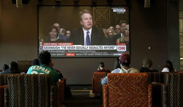 Dozens of college students at Arizona State University watch the Senate Judiciary Committee hearing of Supreme Court nominee Brett Kavanaugh as he testifies Thursday, Sept. 27, 2018, in Phoenix. Kavanaugh testifies regarding the sexual assault allegations by Christine Blasey Ford. (AP Photo/Ross D. Franklin)