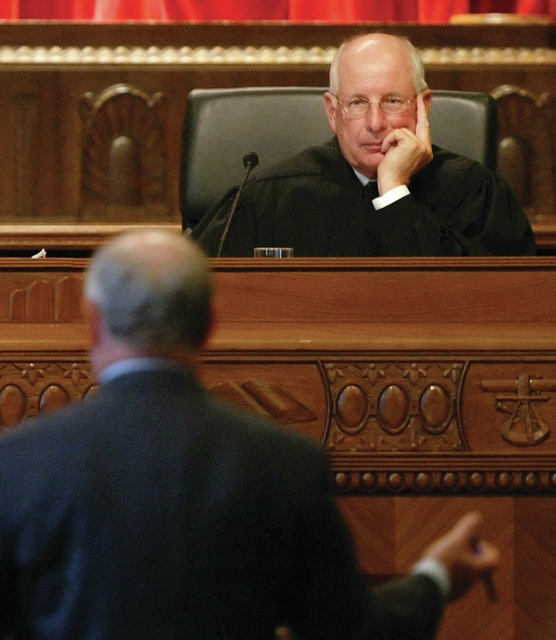 FILE - In this Nov. 29, 2005, file photo, Justice Paul Pfeifer listens to Attorney Donald Mooney present arguments in the Ohio Supreme Court in Columbus, Ohio. Pfeifer says language on gay marriage, pro or con, doesnt belong in the Ohio Constitution. He suggests Ohioans should repeal the states 2004 constitutional ban on gay marriage and leave the issue to state lawmakers to decide. (AP Photo/Will Shilling, File)