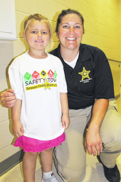 School Resource Officer Deputy Monica Rice poses with Macy Beener at the Big Walnut Safety Town graduation. During the program, 60 youth, ages 5 and 6 from the Sunbury area, completed the week long Safety Town program, which was led by deputies from the Delaware County Sheriff's Office. Five total sessions were held this past summer throughout the county with 250 children participating. The sheriff's office reports local businesses helped offset start-up costs, and community agencies partnered with deputies to bring a variety of safety messages to the students, including water, bicycle, animal, stranger and electrical.