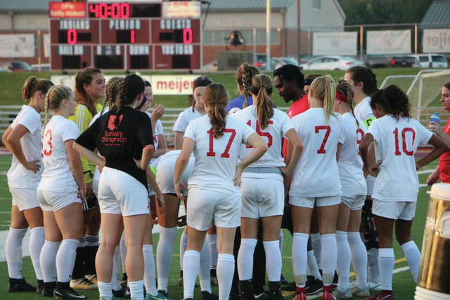 Coach Chris Allen talks to the Big Walnut Girls Varsity Soccer team prior to a match against Olentangy Orange that ended in a scoreless tie at home.