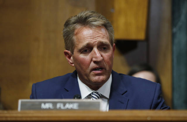Sen. Jeff Flake, R-Ariz., speaks before the Senate Judiciary Committee hearing about an investigation, Friday, Sept. 28, 2018 on Capitol Hill in Washington.   (AP Photo/Pablo Martinez Monsivais)