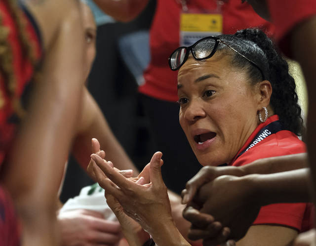 United States coach Dawn Staley gives instructions to her players during the Women's basketball World Cup final match between Australia and the U.S.A. in Tenerife, Spain, Sunday Sept. 30, 2018. (AP Photo/Andres Gutierrez)