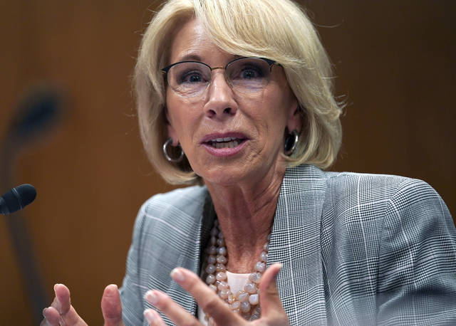 FILE - In this June 5, 2018, file photo, Education Secretary Betsy DeVos testifies during hearing on the FY19 budget on Capitol Hill in Washington. A little-known venture capitalist is on the verge of acquiring one of the country's biggest for-profit colleges, a transaction that would put him in control of a troubled national chain vastly larger than the tiny California school he currently owns.(AP Photo/Carolyn Kaster, File)