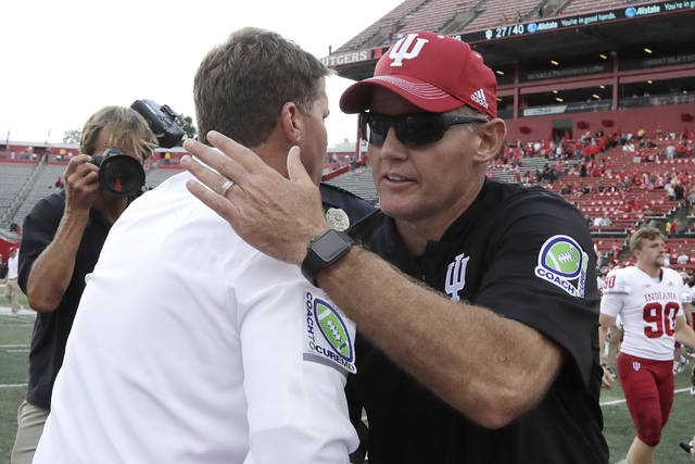 Rutgers head coach Chris Ash, left, shakes hands with Indiana head coach Tom Allen after an NCAA college football game, Saturday, Sept. 29, 2018, in Piscataway, N.J. Indiana won 24-17. (AP Photo/Julio Cortez)