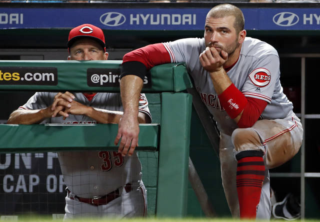 FILE - In this Sept. 5, 2018, file photo, Cincinnati Reds' Joey Votto, right, stands on the dugout steps next to interim manager Jim Riggleman during the fifth inning of a baseball game against the Pittsburgh Pirates, in Pittsburgh. The Reds lost 90 games for the fourth straight season and headed into the offseason unsure who will manage next year. (AP Photo/Gene J. Puskar, File)