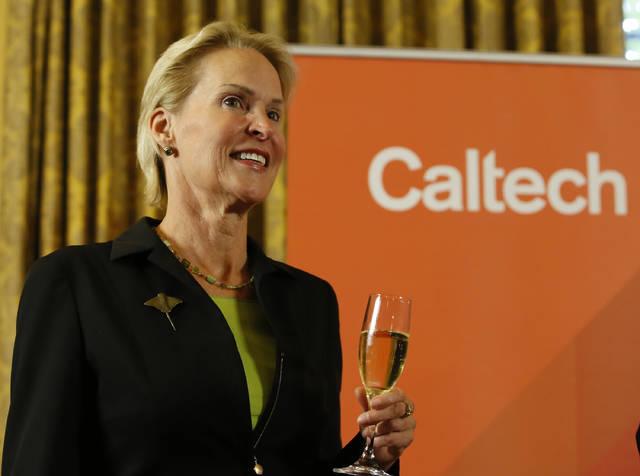 Nobel chemistry winner Frances Arnold makes a toast at California Institute of Technology in Pasadena, Calif., Wednesday, Oct. 3, 2018. (AP Photo/Damian Dovarganes)