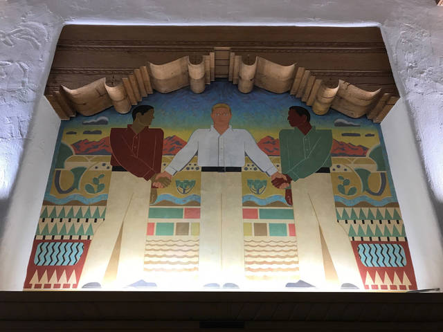 This Great Depression-era mural at the University of New Mexico's Zimmerman Library is the focus of complaints about the depiction of Hispanics and Native Americans, in Albuquerque, N.M., Monday, Oct. 8, 2018.  (AP Photo/Susan Montoya Bryan)