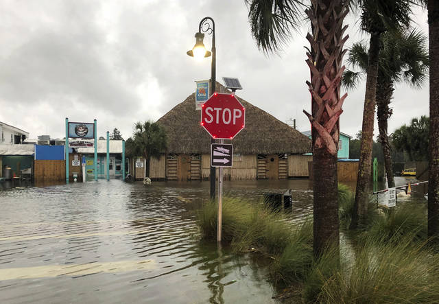 The St. Marks River overflows into the city of St. Marks, Fla., ahead of Hurricane Michael, Wednesday, Oct. 10, 2018.  The hurricane center says Michael will be the first Category 4 hurricane to make landfall on the Florida Panhandle.  (AP Photo/Brendan Farrington)