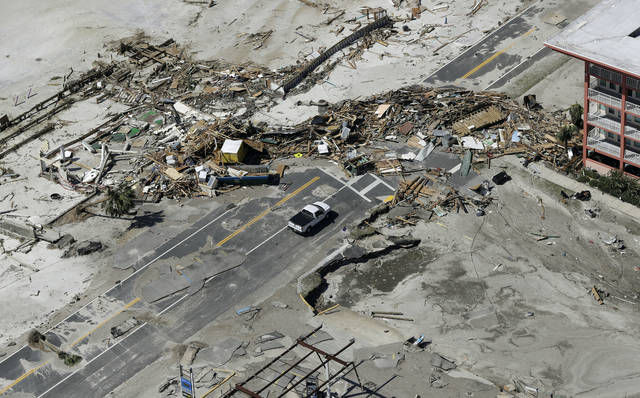 Debris from homes destroyed by Hurricane Michael block a road Thursday, Oct. 11, 2018, in Mexico Beach, Fla. (AP Photo/Chris O'Meara)