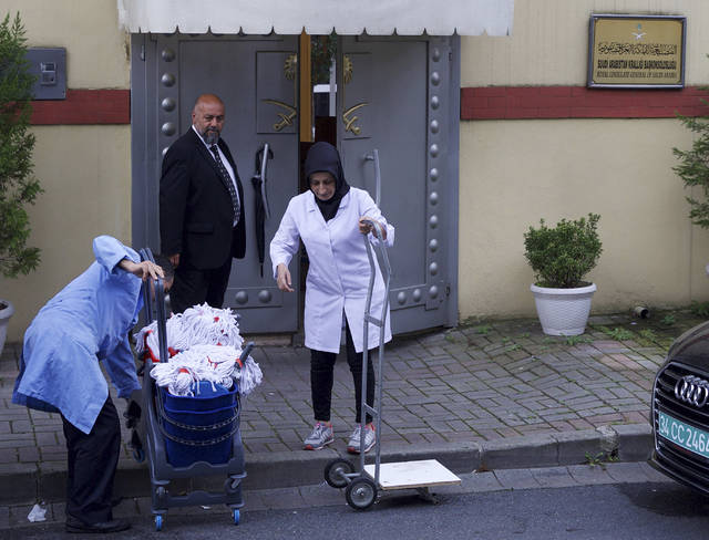 "Cleaning personnel enter Saudi Arabia's Consulate in Istanbul, Monday, Oct. 15, 2018. Turkey says an ""inspection"" of the consulate is expected to take place later on Monday, nearly two weeks after Saudi journalist after Jamal Khashoggi disappeared there. (AP Photo/Petros Giannakouris)"