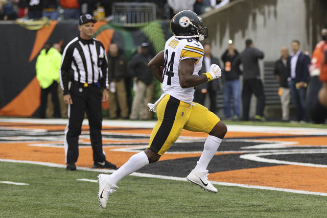 Pittsburgh Steelers wide receiver Antonio Brown (84) runs for a touchdown in the second half of an NFL football game against the Cincinnati Bengals, Sunday, Oct. 14, 2018, in Cincinnati. (AP Photo/Gary Landers)
