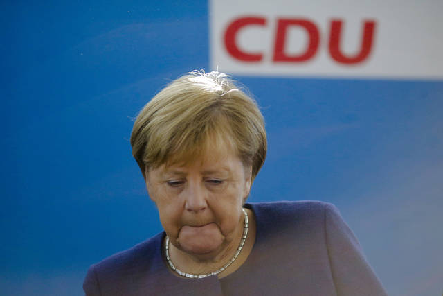 German Chancellor Angela Merkel leads a Christian Democratic Union party's leaders meeting at the party's headquarters a day after the Bavarian state elections, in Berlin, Monday, Oct. 15, 2018. (AP Photo/Markus Schreiber)