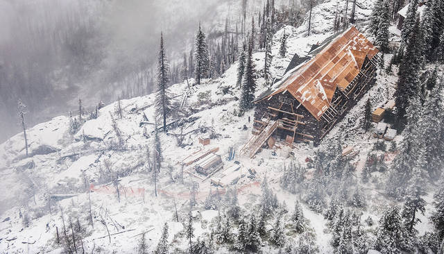 This Oct. 3, 2018 photo provided by the Glacier National Park Conservancy shows progress being made on rebuilding the Sperry Chalet in Glacier National Park, Mont. More than a year after it was gutted by a wildfire, Glacier National Park's beloved Sperry Chalet is slowly rising from the ashes. This month, contractors are putting the finishing touches on the first and second floors of the dormitory building and the roof before wrapping up their work for the season. (Glacier National Park Conservancy via AP)