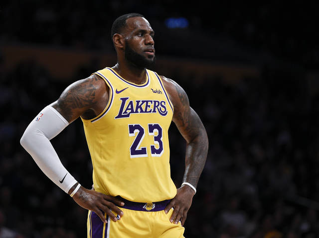 FILE - In this Oct. 4, 2018, file photo, Los Angeles Lakers forward LeBron James looks on during the first half of an NBA preseason basketball game against the Sacramento Kings in Los Angeles. The only certainty in the NBA this season is that James won't win the East _ ending an eight-year run of that, four in Miami and four in Cleveland.(AP Photo/Kelvin Kuo, File)