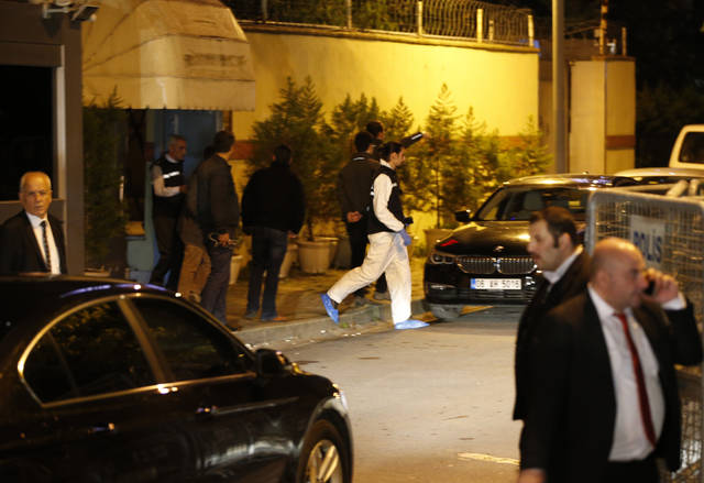 "Turkish police forensic officer exits the Saudi Arabia's Consulate in Istanbul, Monday, Oct. 15, 2018. Turkey and Saudi Arabia are conducting a joint ""inspection"" on Monday of the consulate, where Saudi journalist Jamal Khashoggi went missing nearly two weeks ago, Turkish authorities said.v(AP Photo/Emrah Gurel)"