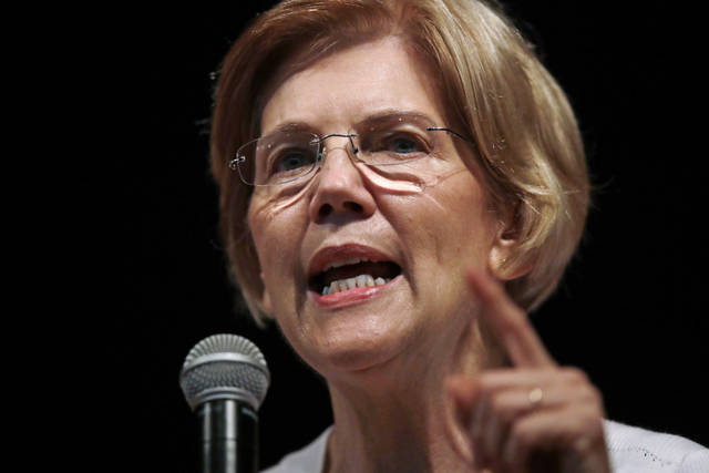 FILE - In this Wednesday, Aug. 8, 2018, file photo, U.S. Sen. Elizabeth Warren, D-Mass., speaks during a town hall-style gathering in Woburn, Ma. A DNA analysis done on Sen. Warren provides strong evidence she has Native American heritage. She provided her test results to The Boston Globe for a story published Monday. (AP Photo/Charles Krupa, File)