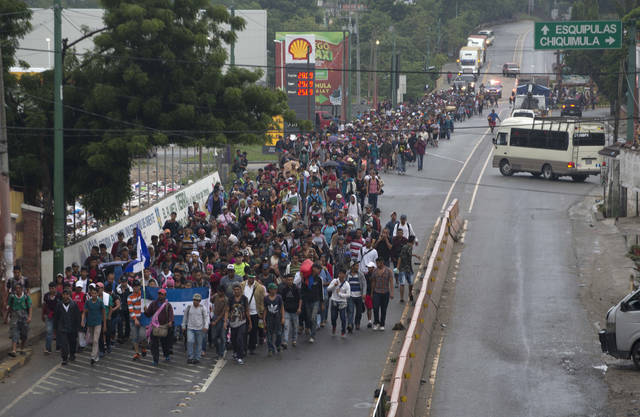 Honduran migrants walking to the U.S. start their day departing Chiquimula, Guatemala, Wednesday, Oct. 17, 2018. The group of some 2,000 Honduran migrants hit the road in Guatemala again Wednesday, hoping to reach the United States despite President Donald Trump's threat to cut off aid to Central American countries that don't stop them. (AP Photo/Moises Castillo)