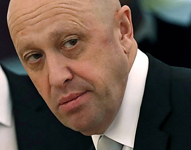 FILE - In this July 4, 2017 file photo, Russian businessman Yevgeny Prigozhin is shown prior to a meeting of Russian President Vladimir Putin and Chinese President Xi Jinping in the Kremlin in Moscow, Russia. An independent Russian newspaper says a security aide of businessman Yevgeny Prigozhin, who has been indicted in the U.S. for trying to interfere with the 2016 U.S. election, says the Russian mogul has been involved in attacks on several people and at least one killing. Novaya Gazeta on Monday, Oct. 22, 2018 published an article quoting a former convict who worked for Prigozhin, Valery Amelchenko, who said he orchestrated attacks on Prigozhin's opponents as well as the killing of an opposition blogger. (Sergei Ilnitsky/Pool Photo via AP, File)