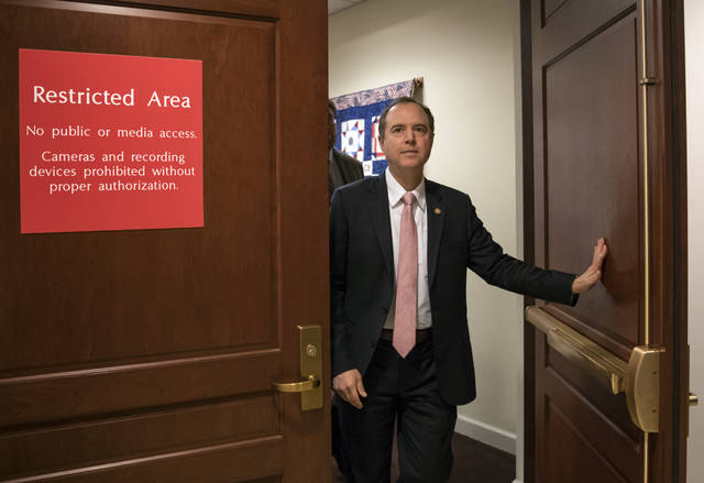 FILE - In this March 22, 2018 file photo, Rep. Adam Schiff, D-Calif., ranking member of the House Intelligence Committee, exits a secure area to speak to reporters, on Capitol Hill in Washington.  House Democrats are expected to re-open the investigation into Russian interference in the 2016 election if they win the majority in the November midterms, but they would have to be selective in what they investigate.  (AP Photo/J. Scott Applewhite)