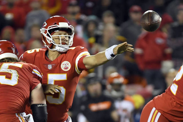Kansas City Chiefs quarterback Patrick Mahomes (15) throws away the ball with his left hand as he is tackled by Cincinnati Bengals defensive tackle Andrew Billings, rear, in the second half of an NFL football game in Kansas City, Mo., Sunday, Oct. 21, 2018. (AP Photo/Reed Hoffmann)