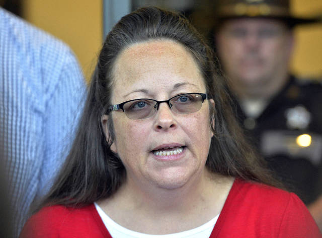 FILE - In this Sept. 14, 2015, file photo, Rowan County Clerk Kim Davis makes a statement to the media at the front door of the Rowan County Judicial Center in Morehead, Ky. Running for re-election, Davis, who was jailed for refusing to issue marriage licenses after gay weddings became legal, has told voters she did not treat anyone unfairly. Davis spoke at a candidate forum Tuesday night, Oct. 23, 2018, with her Democratic rival Elwood Caudill Jr. (AP Photo/Timothy D. Easley, File)