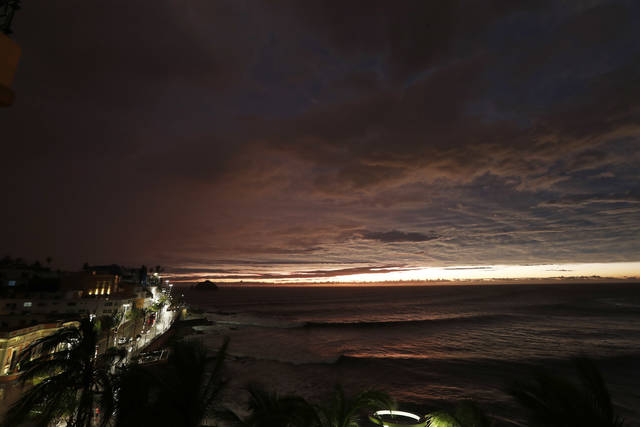 The sun sets, as Hurricane Willa makes landfall, in Mazatlan, Mexico, Tuesday, Oct. 23, 2018. Emergency officials said they evacuated more than 4,250 people in coastal towns and set up 58 shelters ahead of the dangerous Category 3 storm. (AP Photo/Marco Ugarte)