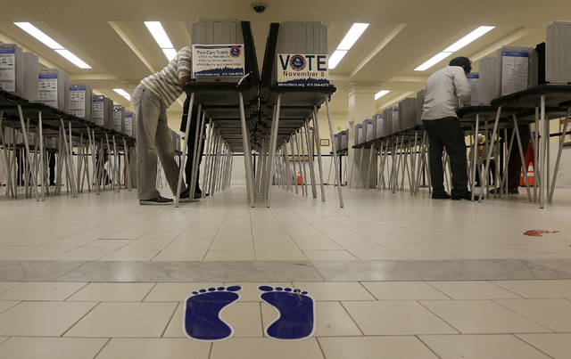 File - In this Nov. 8, 2016, file photo, voters cast ballots at City Hall in San Francisco. San Francisco will become the first city in California and one of only a handful nationwide to allow noncitizens to vote in a local election in November. They're only allowed to vote in the school board race. (AP Photo/Jeff Chiu, File)