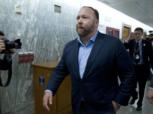 FILE - In this Wednesday, Sept. 5, 2018, file photo, Alex Jones, the right-wing conspiracy theorist, walks the corridors of Capitol Hill after listening to testimony on Capitol Hill in Washington. On Tuesday, Oct. 23, 2018, Twitter confirmed it has removed accounts linked to conspiracy-monger Alex Jones and Infowars. (AP Photo/Jose Luis Magana, File)