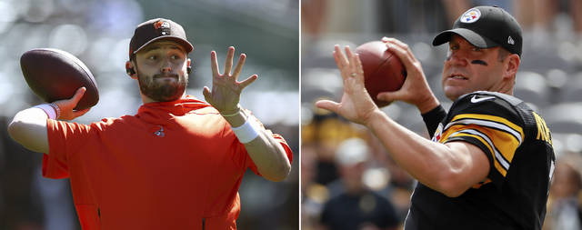 FILE - At left, in a Sept. 30, 2018, file photo, Cleveland Browns quarterback Baker Mayfield warms up before an NFL football game against the Oakland Raiders, in Oakland, Calif. At right, in a Sept. 16, 2018, file photo, Pittsburgh Steelers quarterback Ben Roethlisberger warms up before an NFL football game against the Kansas City Chiefs, in Pittsburgh. Cleveland's rookie quarterback will get a shot at the Steelers (3-2-1) on Sunday when the Browns (2-4-1) try win in Pittsburgh for the first time in 15 years. (AP Photo/File)