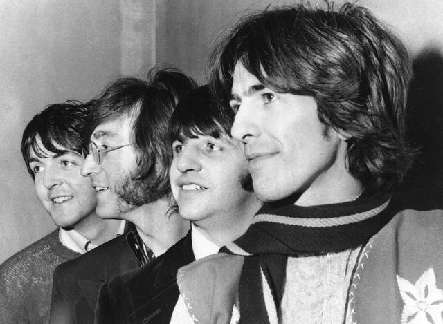 "FILE - This Feb. 28, 1968 file photo shows The Beatles, from left, Paul McCartney, John Lennon, Ringo Starr and George Harrison. The Beatles have released a new music video on Apple Music for their 1968 song, ""Glass Onion."" The video was released Tuesday and features rare photos and performance footage. The song appeared on their self-titled ninth album, often referred to as the ""White Album,"" which celebrates its 50th anniversary this year. (AP Photo, File)"