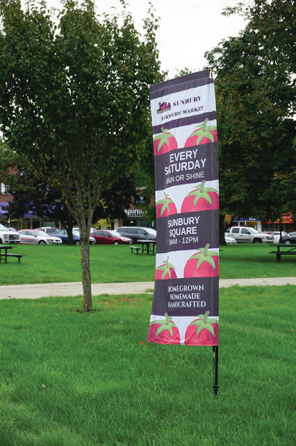 A banner for the weekly Farmer's Market, which will end for the season on Oct. 13.