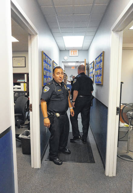 Narrow hallways are the rule at the Genoa Township Police Department building. Lt. Rich Lyon, left, and Chief of Police Stephen Gammill, right, have to turn sideways to pass each other.
