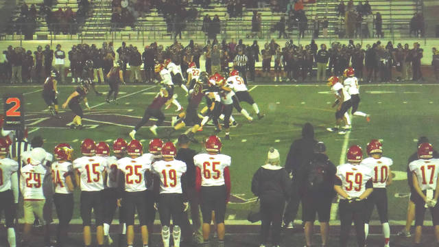 Big Walnut's offense runs a second down play in the rain against New Albany on Oct. 12.