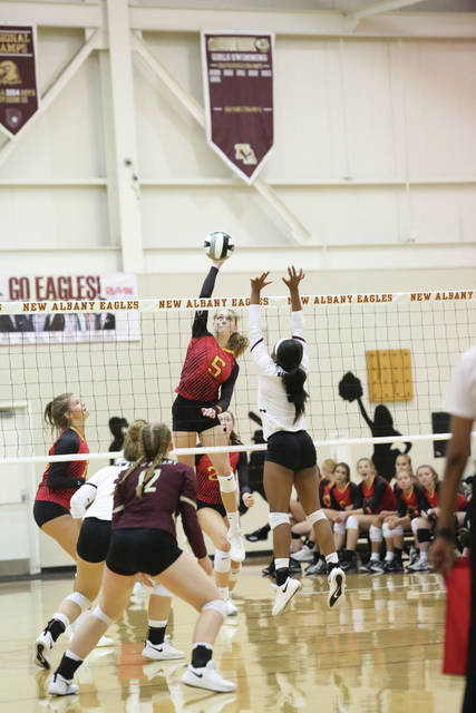 Junior Kassie Bowmar goes for the kill in a varsity volleyball game earlier this season.