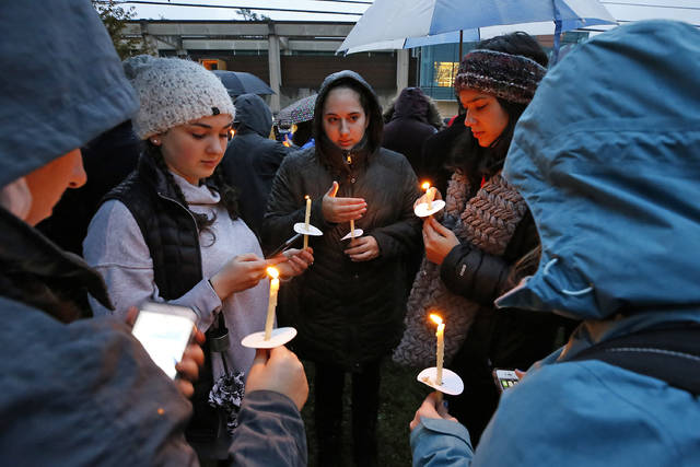 Holding candles, a group of girls wait for the start of a memorial vigil at the intersection of Murray Ave. and Forbes Ave. in the Squirrel Hill section of Pittsburgh, for the victims of the shooting at the Tree of Life Synagogue where a shooter opened fire, killing multiple people and wounding others, including sevearl police officers, Saturday, Oct. 27, 2018. (AP Photo/Gene J. Puskar)