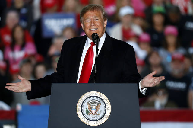In this Oct. 27, 2018, photo, President Donald Trump speaks during a rally at Southern Illinois Airport in Murphysboro, Ill. Eager to focus voters on immigration in the lead-up to the midterm elections, Trump on Oct. 29 escalated his threats against a migrant caravan trudging slowly toward the U.S. border as the Pentagon prepared to deploy thousands of U.S. troops to support the border patrol. (AP Photo/Jeff Roberson)