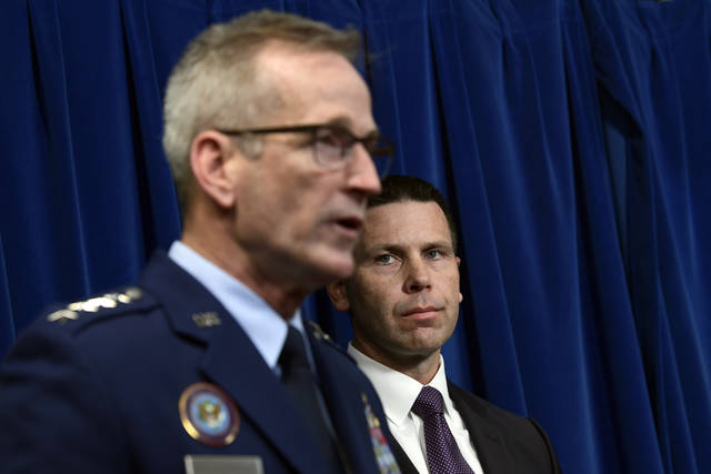 U.S. Customs and Border Protection Commissioner Kevin McAleenan, right, listens as Commander of United States Northern Command and North American Aerospace Defense Command Gen. Terrence John O'Shaughnessy, left, speaks during a news conference in Washington, Monday, Oct. 29, 2018, on the Department of Defense deployment to the Southwest border. (AP Photo/Susan Walsh)