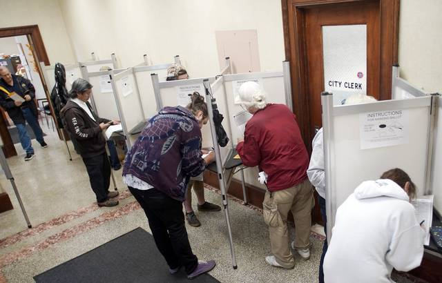 The Pittsfield, Mass., City Hall is packed with voters on the last day of early voting in Massachusetts, Friday, Nov. 2, 2018. (Ben Garver/The Berkshire Eagle via AP)