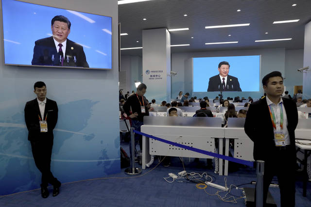 Chinese President Xi Jinping is seen on a live broadcast at the media center during the opening ceremony for the China International Import Expo in Shanghai, Monday, Nov. 5, 2018. Xi promised Monday to open China wider to imports at the start of a high-profile trade fair meant to rebrand the country as a global customer but offered no response to U.S. and European complaints about technology policy and curbs on foreign business. (AP Photo/Ng Han Guan)