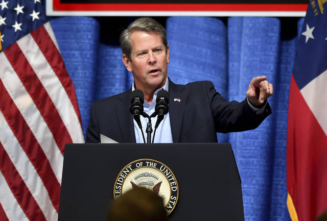 In this Thursday, Nov. 1, 2018, photo, Georgia Republican gubernatorial candidate Brian Kemp speaks during a rally at the Columbia County Exhibition Center in Grovetown, Ga. The official office of Georgia Secretary of State Brian Kemp said Sunday, Nov. 4, it is investigating the state Democratic Party in connection with what it said was an attempted hack of the state's online voter database that will be used at polling places in Tuesday's election. (Michael Holahan/The Augusta Chronicle via AP)