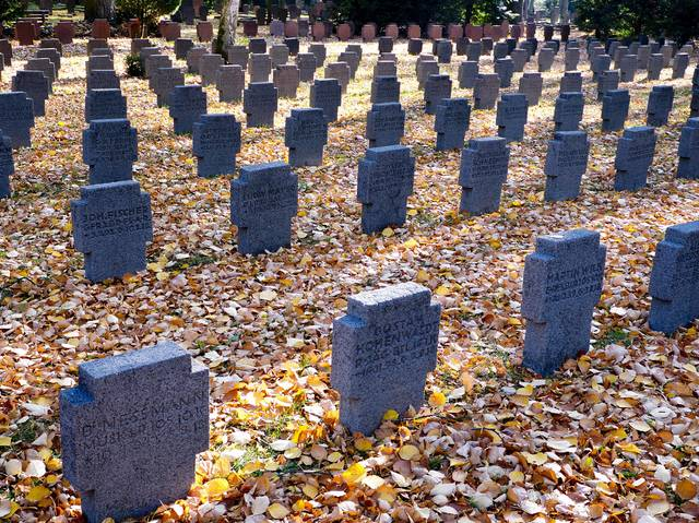 A field of graves belonging to WWI soldiers in the main cemetery in Frankfurt, Germany, Saturday, Nov. 3, 2018. German Chancellor Angela Merkel will mark the 100th anniversary of the end of World War I on French soil, and President Frank-Walter Steinmeier will be in London's Westminster Abbey for a ceremony with the queen. But in Germany, there are no national commemorations planned for the centenary of the Nov. 11 armistice that brought an end to the bloody conflict that killed more than 2 million of its troops and left 4 million wounded. That's because the armistice did not bring peace to Germany. (AP Photo/Michael Probst)