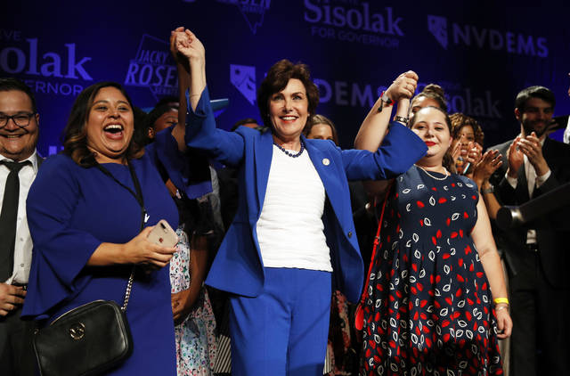 Rep. Jacky Rosen, D-Nev., center, celebrates at a Democratic election night party after winning a Senate seat Wednesday, Nov. 7, 2018, in Las Vegas. A female political movement driven by backlash to President Donald Trump kicked off 2018 by hosting a women's march in Nevada and 11 months later, that activism helped women win key races across the state, including ousting an incumbent U.S. Senator, electing a female-majority federal delegation and a female-majority state Assembly. (AP Photo/John Locher)